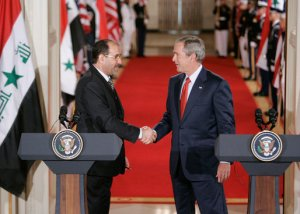 George W. Bush and Nouri al-Maliki shaking hands at the White House in 2006. Photo: Wikimedia Commons